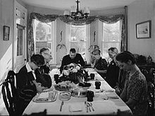Saying grace before carving the turkey at Thanksgiving dinner in the home of Earle Landis in Neffsville, Pennsylvania. (1942)